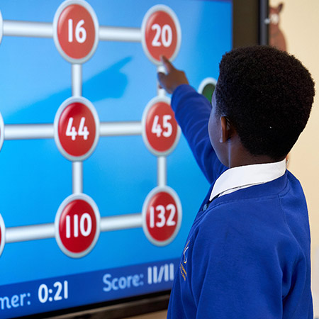St Andrew's Primary - Pupil On Interactive Smart Board